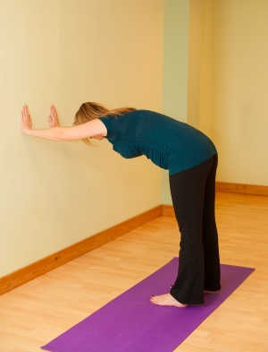 downward dog at wall yoga pubic symphysis